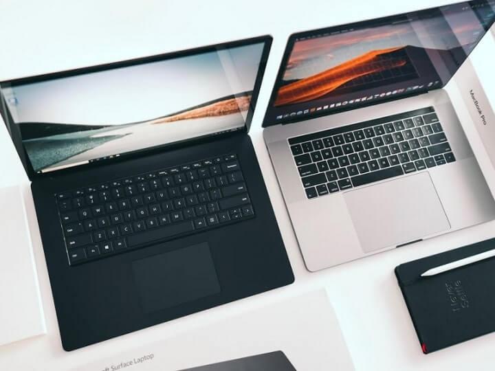 so sánh pin macbook và surface